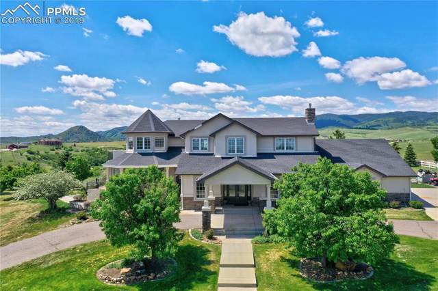 5095 Horseshoe Trail, Sedalia, CO 80135 (#1847603) :: Tommy Daly Home Team