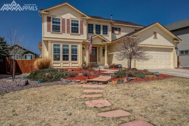 10368 Mt. Evans Drive, Peyton, CO 80831 (#1852024) :: The Treasure Davis Team