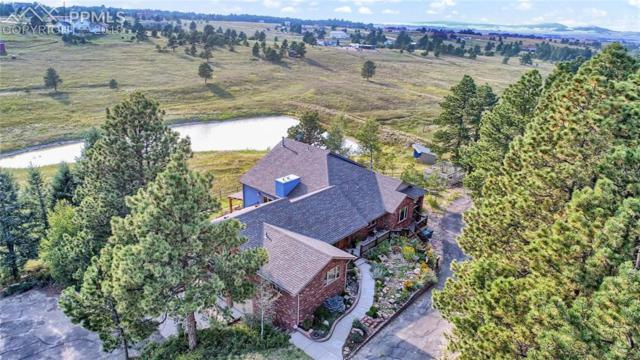 18140 Walker Court, Colorado Springs, CO 80908 (#1920374) :: The Hunstiger Team
