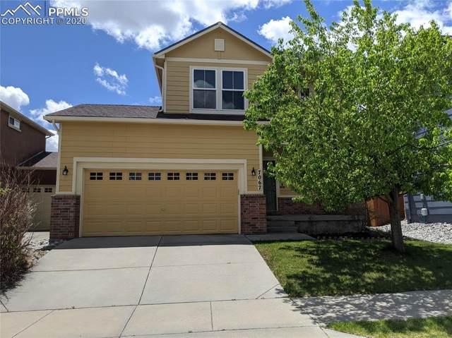 7067 Silverwind Circle, Colorado Springs, CO 80923 (#2088338) :: The Daniels Team