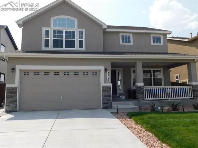 8121 Burl Wood Drive, Colorado Springs, CO 80908 (#2103463) :: Action Team Realty
