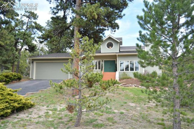 19325 Robin Hood Way, Monument, CO 80132 (#2104236) :: The Hunstiger Team