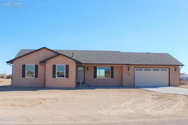 1676 E Parlin Drive, Pueblo West, CO 81007 (#2177363) :: The Hunstiger Team