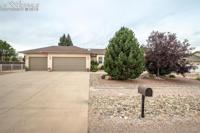 578 W Golfwood Drive, Pueblo West, CO 81007 (#2261355) :: The Hunstiger Team
