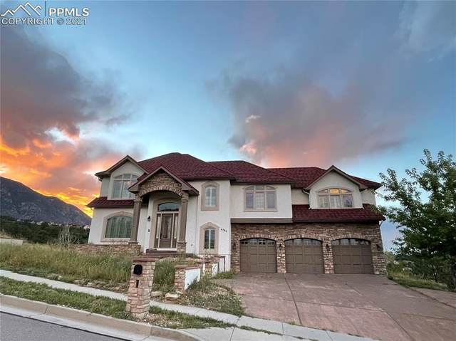4780 Broadmoor Bluffs Drive, Colorado Springs, CO 80906 (#2306536) :: Tommy Daly Home Team