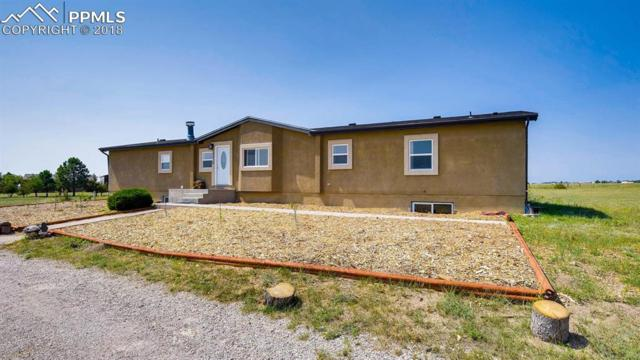 10210 S Heritage Park Trail, Peyton, CO 80831 (#2307655) :: CENTURY 21 Curbow Realty
