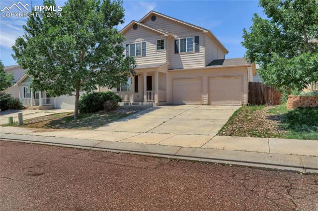 310 Audubon Drive, Colorado Springs, CO 80910 (#2309684) :: The Hunstiger Team