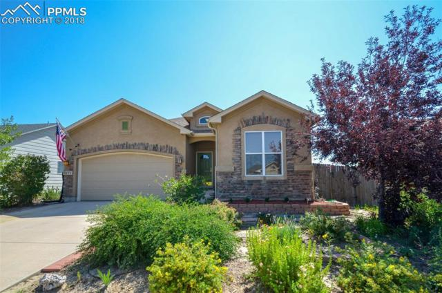 3171 Poughkeepsie Drive, Colorado Springs, CO 80916 (#2332309) :: The Hunstiger Team