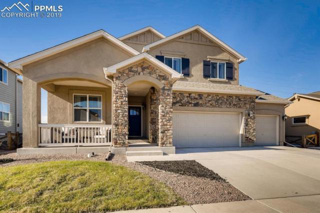 8598 Moorland Lane, Colorado Springs, CO 80927 (#2343844) :: The Hunstiger Team