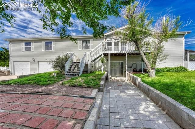 15270 Storybook Lane, Colorado Springs, CO 80928 (#2351018) :: Fisk Team, RE/MAX Properties, Inc.