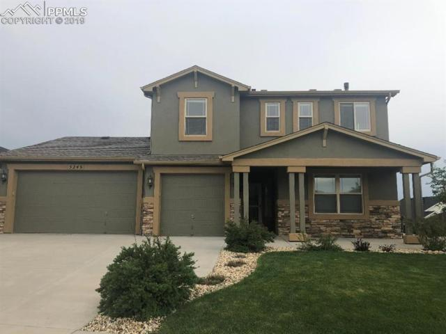 5249 Gem Lake Court, Colorado Springs, CO 80924 (#2426521) :: The Treasure Davis Team