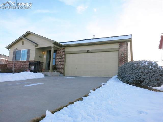 2061 Dewhirst Drive, Colorado Springs, CO 80951 (#2451290) :: The Treasure Davis Team