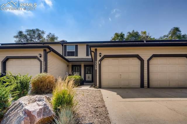 2309 Lexington Village Lane, Colorado Springs, CO 80916 (#2451940) :: Tommy Daly Home Team