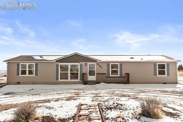 17555 Wagon Train Loop, Peyton, CO 80831 (#2453282) :: The Harling Team @ HomeSmart