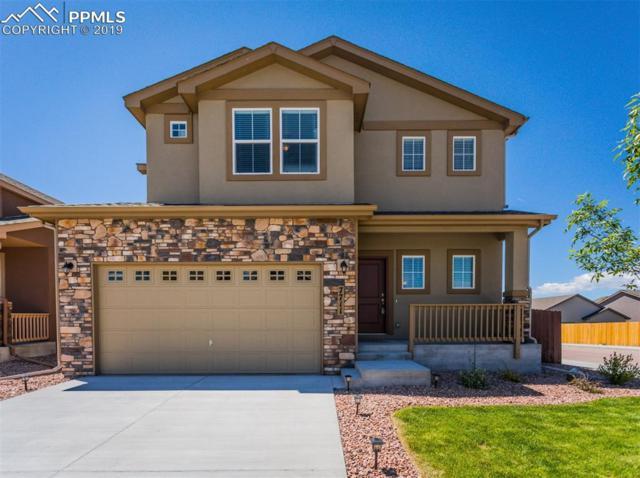 7711 Barraport Drive, Colorado Springs, CO 80908 (#2453927) :: Compass Colorado Realty
