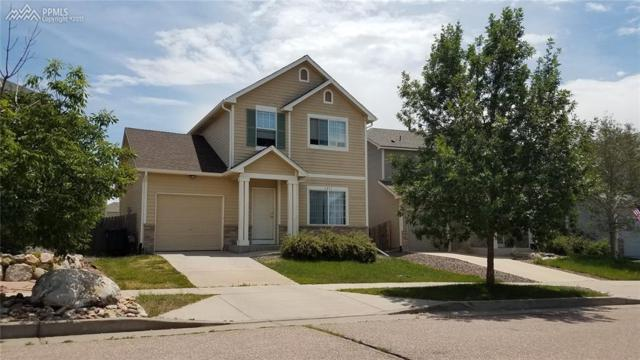 6291 Scottsbluff Drive, Colorado Springs, CO 80923 (#2496207) :: The Hunstiger Team