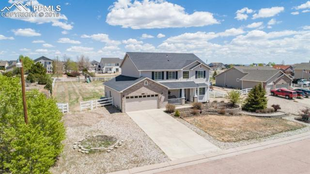 8253 Del Rio Road, Peyton, CO 80831 (#2576340) :: The Kibler Group