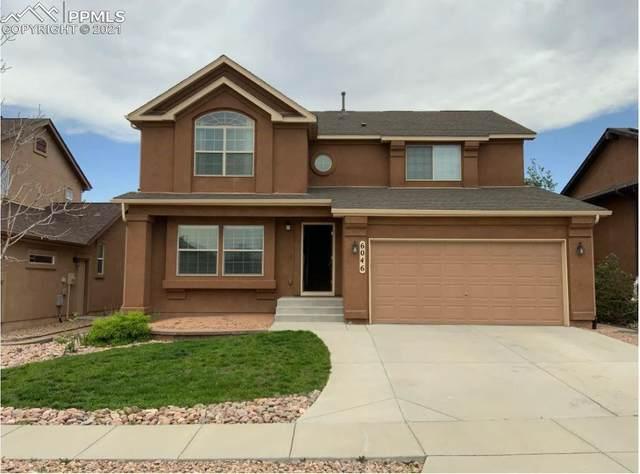 6046 Harney Drive, Colorado Springs, CO 80924 (#2584777) :: Hudson Stonegate Team