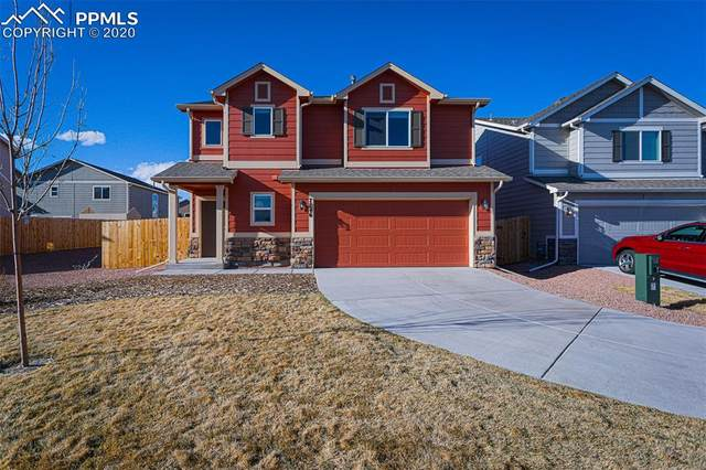 7746 Swingarm Grove, Peyton, CO 80831 (#2613132) :: The Kibler Group