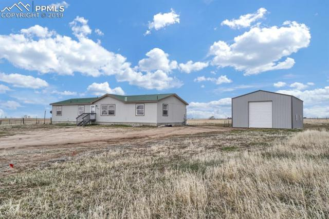 11150 N Ellicott Highway, Calhan, CO 80808 (#2704416) :: Tommy Daly Home Team