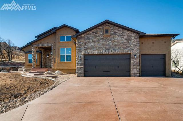 8020 Hedgewood Way, Colorado Springs, CO 80919 (#2715281) :: The Hunstiger Team