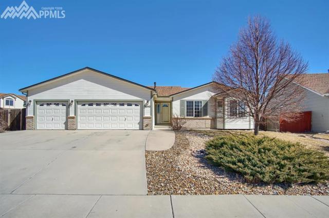 8242 Hidden Pine Drive, Colorado Springs, CO 80925 (#2722832) :: The Treasure Davis Team