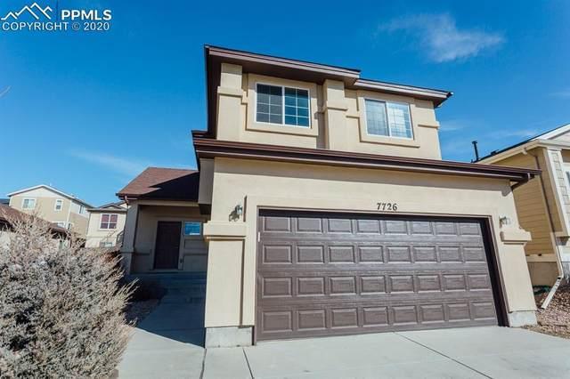 7726 Orange Sunset Drive, Colorado Springs, CO 80922 (#2777818) :: The Peak Properties Group
