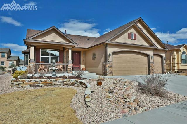 5922 Wolf Village Drive, Colorado Springs, CO 80924 (#2886592) :: The Hunstiger Team