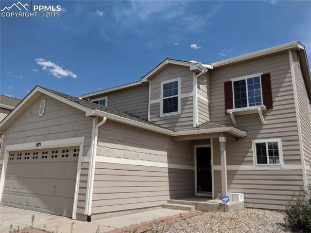 1575 Woodpark Drive, Colorado Springs, CO 80951 (#2925728) :: Action Team Realty