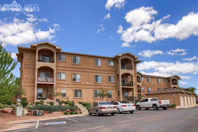 1530 Little Bear Creek Point #302, Colorado Springs, CO 80904 (#2990748) :: The Peak Properties Group