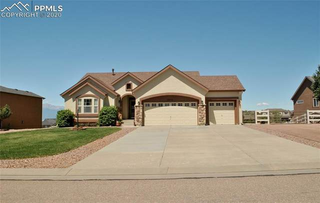 9810 Carrington Drive, Peyton, CO 80831 (#3051996) :: Finch & Gable Real Estate Co.