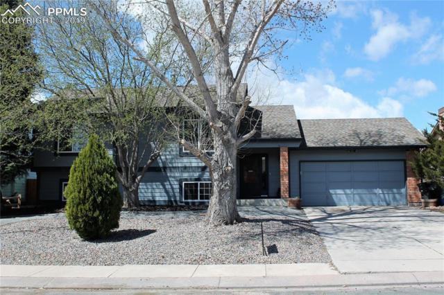 6830 Meadowwood Place, Colorado Springs, CO 80918 (#3101353) :: Venterra Real Estate LLC