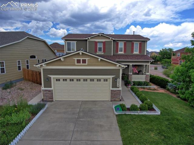 7034 Silverwind Circle, Colorado Springs, CO 80923 (#3117033) :: Tommy Daly Home Team