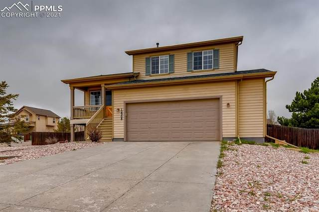 12908 Casa De Campo Road, Peyton, CO 80831 (#3119639) :: CC Signature Group