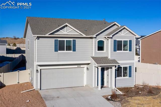 8684 Vanderwood Road, Colorado Springs, CO 80908 (#3249926) :: Tommy Daly Home Team