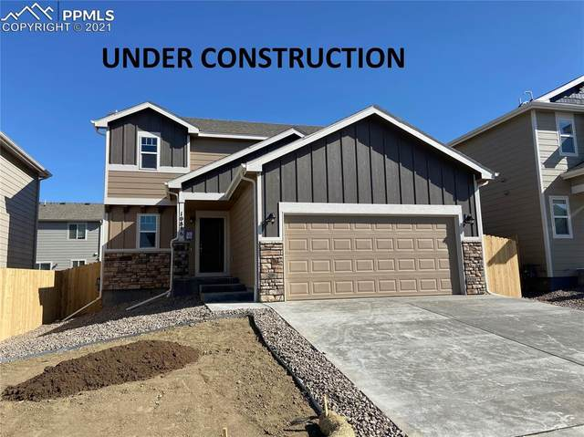 10728 Witcher Drive, Colorado Springs, CO 80925 (#3388426) :: The Gold Medal Team with RE/MAX Properties, Inc