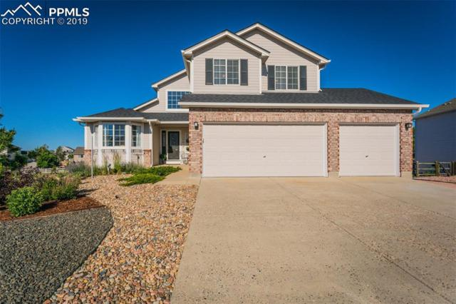 8672 Champie Road, Peyton, CO 80831 (#3394067) :: The Peak Properties Group