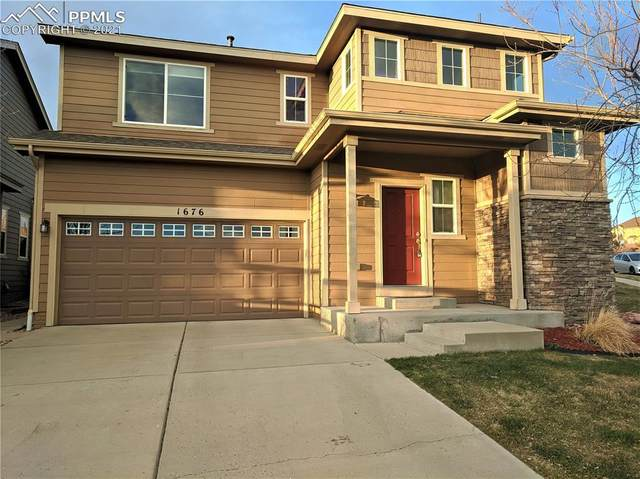 1676 Smokey Ridge Way, Colorado Springs, CO 80921 (#3437005) :: The Artisan Group at Keller Williams Premier Realty