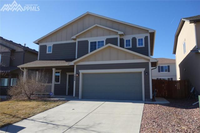 1924 Reed Grass Way, Colorado Springs, CO 80915 (#3442747) :: The Hunstiger Team
