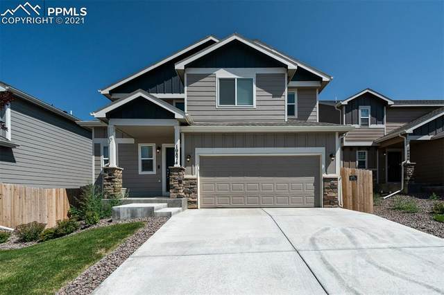 10874 Rowley Drive, Colorado Springs, CO 80925 (#3445225) :: Tommy Daly Home Team