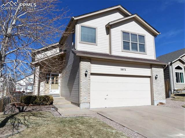 5971 Leather Drive, Colorado Springs, CO 80923 (#3457322) :: The Cutting Edge, Realtors