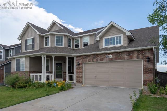 16534 E Fire Fly Avenue, Parker, CO 80134 (#3463670) :: The Peak Properties Group