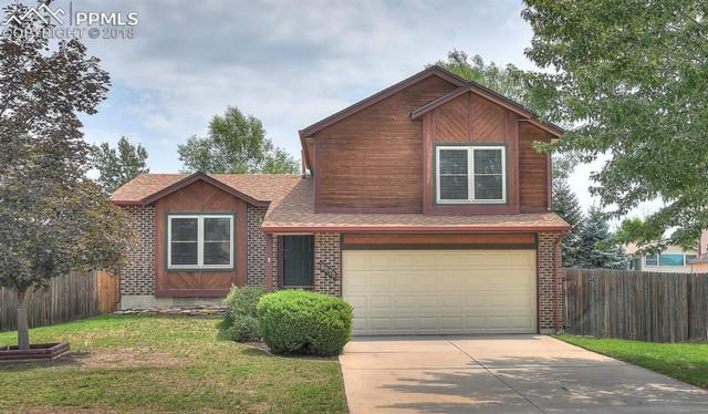 6875 Sagewood Court, Colorado Springs, CO 80918 (#3481297) :: The Hunstiger Team