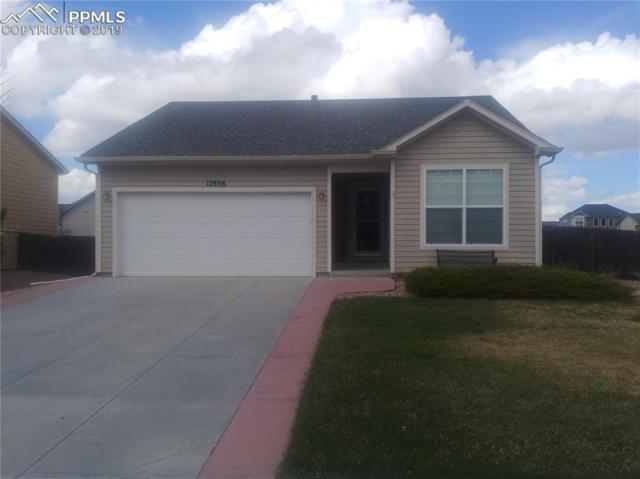 12898 Oakland Hills Road, Peyton, CO 80831 (#3513947) :: Harling Real Estate