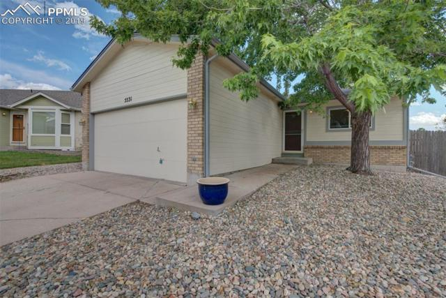 5531 Many Springs Drive, Colorado Springs, CO 80923 (#3529821) :: Tommy Daly Home Team