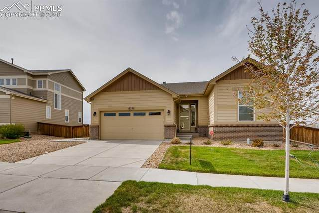 12291 Village Circle, Commerce City, CO 80603 (#3626784) :: The Daniels Team