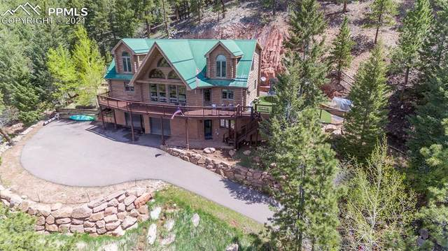1410 Kings Crown Road, Woodland Park, CO 80863 (#3637224) :: Compass Colorado Realty