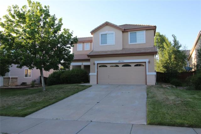 19751 58th Place, Aurora, CO 80019 (#3646299) :: Fisk Team, RE/MAX Properties, Inc.