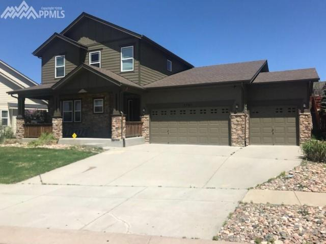7405 Chancellor Drive, Colorado Springs, CO 80920 (#3703264) :: Fisk Team, RE/MAX Properties, Inc.