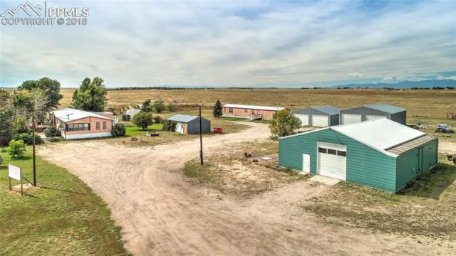 9450 N Ellicott Highway, Calhan, CO 80808 (#3900697) :: The Hunstiger Team